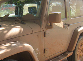 Mud covered Jeep Wrangler rental